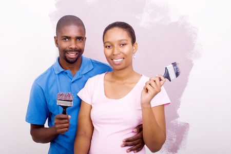 young african american couple painting photo