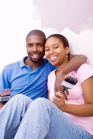 happy african american couple painting home photo