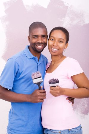 african american couple painting home photo