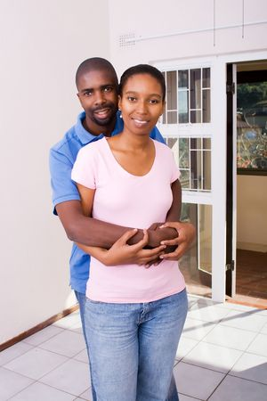 happy african couple first home photo