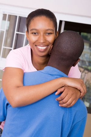 happy african couple hugging  photo