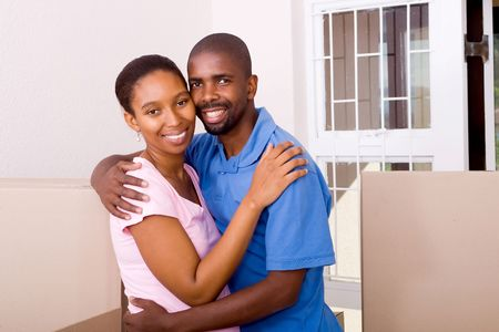 happy african couple move in together photo