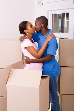 african american young couple kissing in new home photo