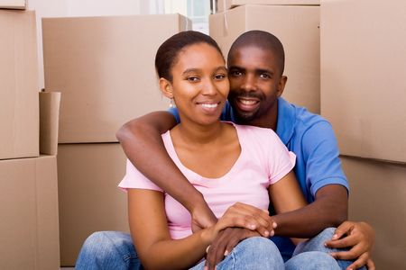 happy young african american couple moving to new home photo