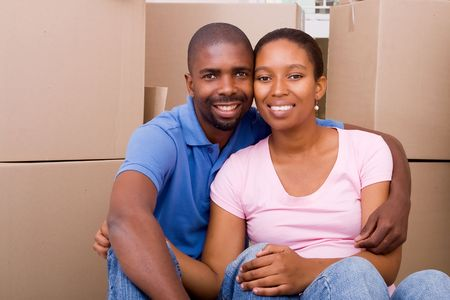 family moving house: happy couple moving in together Stock Photo