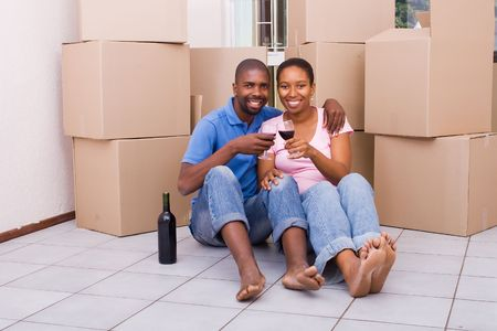 alcohol cardboard: african american couple celebrating new home