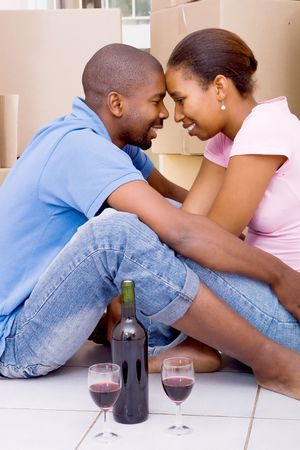 african american couple celebrate their new home Stock Photo - 5493278