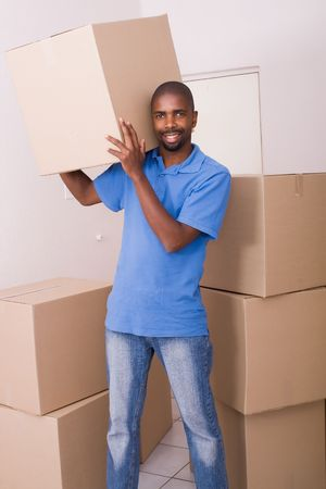 african american man moving apartment photo