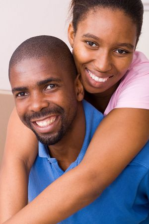 happy african american couple piggy back photo