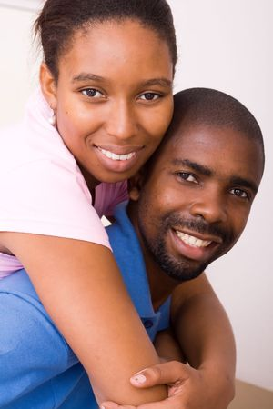 young happy african american couple piggy back Stock Photo - 5493274
