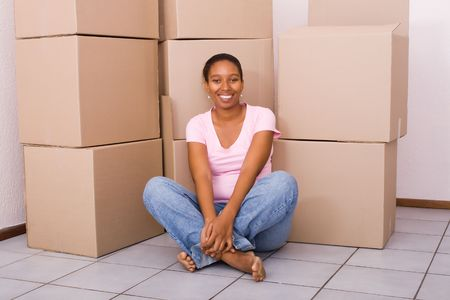 young african american woman in her new apartment Stock Photo - 5493242