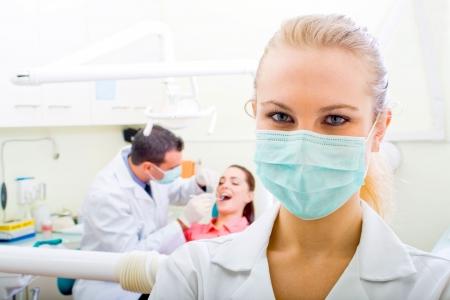foreground: happy confident female dentist Stock Photo