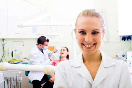friendly female dentist in dental practice Stock Photo - 5715918