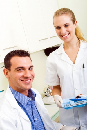 women s health: friendly dentist and dental assistant