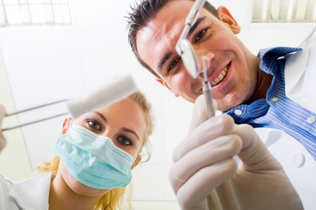 dentist and assistant working on patient photo