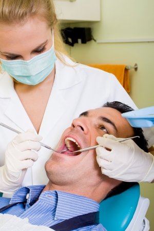 young man visiting female dentist photo
