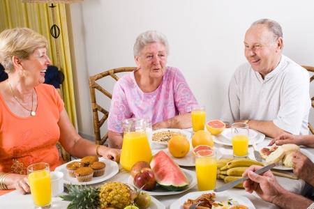 happy seniors friends having breakfast together photo