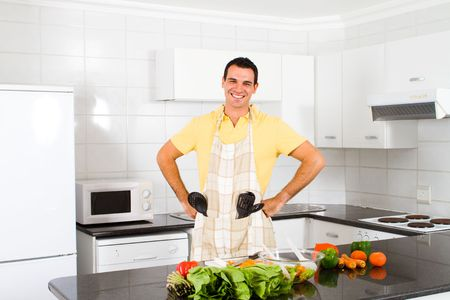 kitchen apron: happy man in kitchen Stock Photo