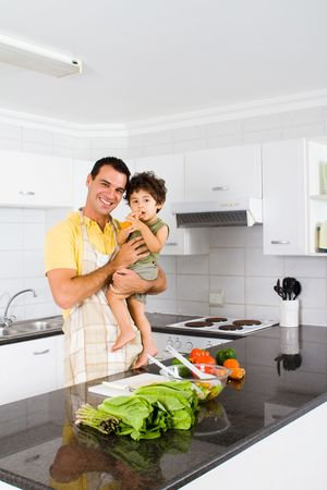 happy father and son in modern kitchen photo