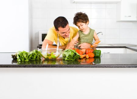 counters: happy father and son cooking in modern kitchen