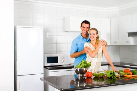 couple love in kitchen photo