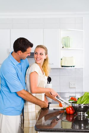 lovely couple in modern kitchen photo