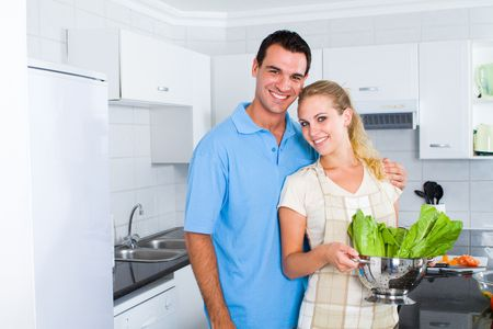 lovely young couple portrait in modern kitchen photo