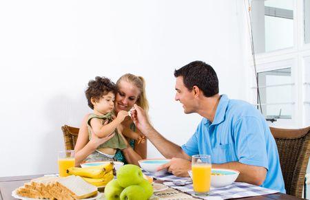 father feeding baby boy photo