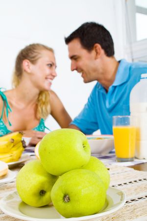 young couple at breakfast table photo