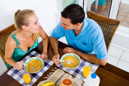 breakfast room: happy young couple having healthy breakfast together Stock Photo
