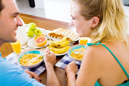 young couple having healthy breakfast together photo