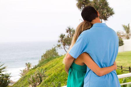 balcony: couple hugging