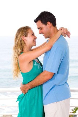 happy young couple embracing photo