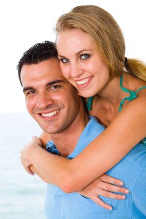 happy young couple piggyback photo