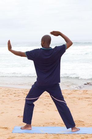 man exercising on beach photo