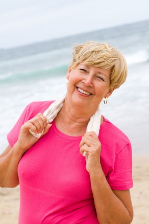 senior woman taking a break after doing exercise photo