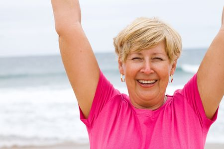 happy elderly doing fitness working out on beach photo