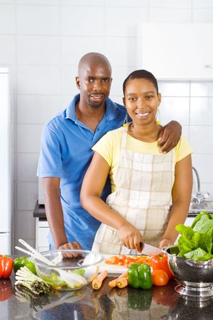 joyful young couple cooking photo