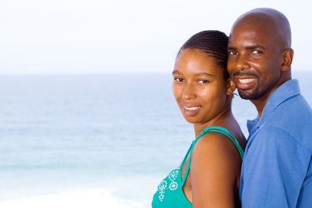 smiling young african couple at beach Stock Photo - 6656237
