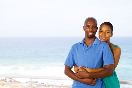 african american couple cuddling Stock Photo - 6656209