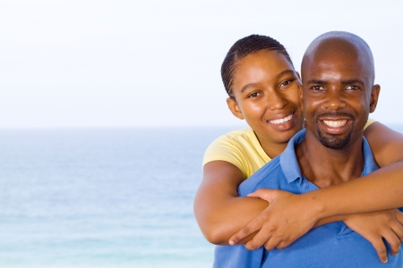 cuddles: african couple Stock Photo