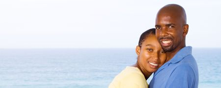 happy hugging african american couple photo