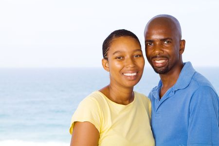 african couple by the sea photo