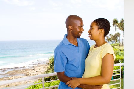 african couple embracing  photo