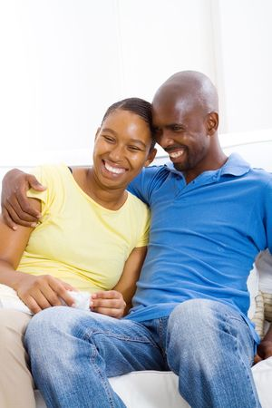 smiling african couple at home photo