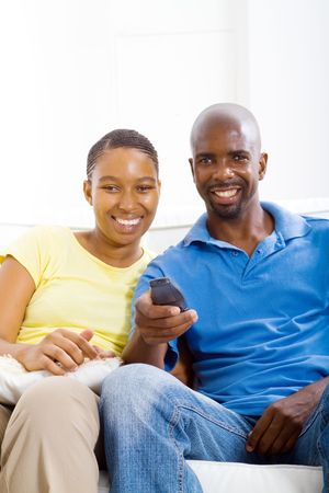 african couple watching tv photo