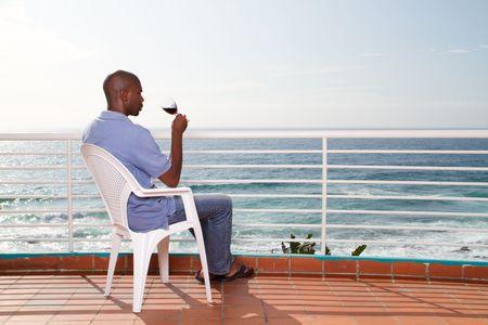 african man drinking wine photo