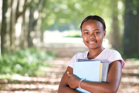 young african american student in park photo