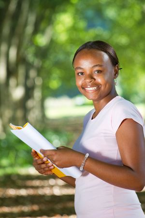 happy african student studying in park photo