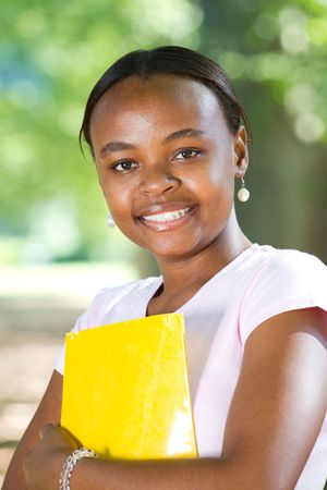 african student: happy young african student